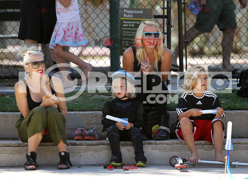 What a cool family outing! Gwen Stefani took her boys Kingston and Zuma to a park on Saturday. Already a ladies man, Kingston_chatted up a nearby girl while_Zuma in his Super Hero costume cruised around on the scooter. And in the end everyone got an icecream treat! Gwen was so taken with her boys, she snapped some pics for the family album! Los Angeles, California on 25.8.2012..Credit: Vida/face to face /MediaPunch Inc. ***FOR USA ONLY*** ***Online Only for USA Weekly Print Magazines*** /NortePhoto.com<br /> <br /> **SOLO*VENTA*EN*MEXICO**<br /> **CREDITO*OBLIGATORIO** *No*Venta*A*Terceros*<br /> *No*Sale*So*third* ***No*Se*Permite*Hacer Archivo***No*Sale*So*third*