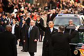 United States President Barack Obama waves as the presidential inaugural parade winds through the nation's capital January 21, 2013 in Washington, DC. Barack Obama was re-elected for a second term as President of the United States. .Credit: Chip Somodevilla / Pool via CNP