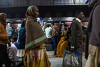 Passengers wait for trains on the platform at the Varanasi city railway station in Varanasi, Uttar Pradesh, India on 17 November 2013. Varanasi is a major religious tourist city and in the sex trade, a major source, transit and destination point for trafficked girls and women.
