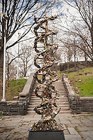 """DNA Totem"" by the artist Suprina Kenney is seen in Marcus Garvey (Mount Morris) Park in Harlem in New York on Saturday, April 2, 2016. The 9-foot tall public sculpture represents a strand of DNA and is made of steel in which the artist has embedded discarded objects that she has found on the streets. The sculpture will be on view until September 30, 2016.  (© Richard B. Levine)"