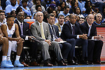 15 November 2015: UNC head coach Roy Williams (third from left) with North Carolina's Nate Britt and assistant coaches Steve Robinson, C.B. McGrath, Hubert Davis, and Brad Frederick. The University of North Carolina Tar Heels hosted the Fairfield University Stags at the Dean E. Smith Center in Chapel Hill, North Carolina in a 2015-16 NCAA Division I Men's Basketball game. UNC won the game 92-65.