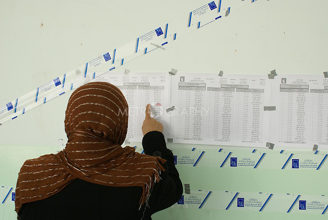 HALABJA, IRAQ: A woman looks at the voting lists in Halabja...On March 7th, 2010, Iraq held nationwide parliamentary elections.