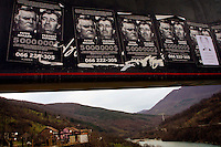 Wanted posters for Radovan Karadzic and Ratko Mladic on an advertising board near the town of Foca in Republica Srpska. Karadzic was believed to spend much of his time in these hills before his arrest in 07/2008.