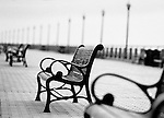Park benches on the boardwalk at Liberty Park in New Jersey.