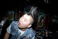 A punk rock musician performs at Castle Bar in Nanjing, China.