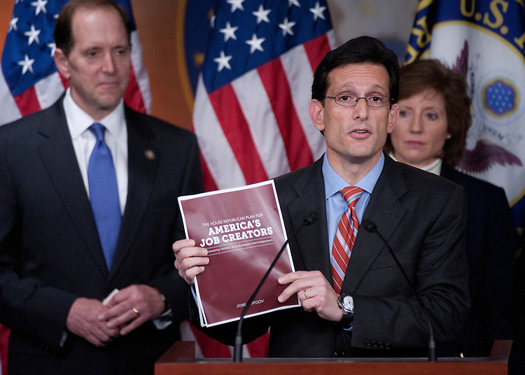 """UNITED STATES - MAY 26: House Majority Leader Eric Cantor, R-Va., speaks during a news conference with House Republican members to unveil a """"pro-growth job creation agenda"""" in the U.S. Capitol on Thursday, May 26, 2011. In the background from left are House Ways and Means Chairman Dave Camp, R-Mich., and Rep. Vicky Hartzler. (Photo By Bill Clark/Roll Call)"""