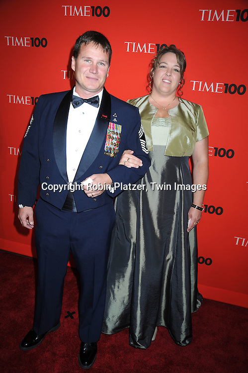 Sgt Tony Harris and wife posing for photographers at the Time Celebrates the Time100 Issue Gala on May 4, 2010 at The Time Warner Center in New York City. The magazine celebrates the 100 Most Influential People in the World.