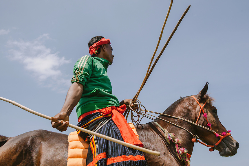 A Pasola warrior ready to charge the enemy forces during the event in Homba Kalayo, Kodi. Pasola is an ancient tradition from the Indonesian island of Sumba. Categorized as both extreme traditional sport and ritual, Pasola is an annual mock horse warfare performed in response to the harvesting season. In the battelfield, the Pasola warriors use blunt spears as their weapon. However, fatal accident still do occurs.