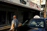 "Taxi driver Jose Alcocer waits for customers crossing into the city from Mexico on August 19, 2010 in Laredo, Texas. Alcocer claims to have made eight to ten trips per day into Mexico by American tourists before the start of the increase in border violence in recent years. Now he says he is lucky to make two or three. ""We don't even make enough for beans,"" said Alcocer."