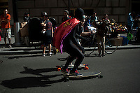 People take part during  the Annual skateboard marathon known as Broadway Bomb  in New York,  October 12, 2013, Photo by Kena Betancur / VIEWpress.