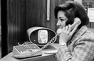 1965, USA --- An office worker uses Bell Telephone Company's Videophone, developed in 1965, for a video conference. --- Image by © JP Laffont