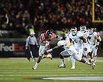 Ole Miss wide receiver Vince Sanders (10) is tackled by Mississippi State defensive back Jay Hughes (30) at Vaught Hemingway Stadium in Oxford, Miss. on Saturday, November 24, 2012. Ole Miss won 41-24.