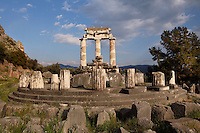 DELPHI, GREECE - APRIL 11 : A view from behind of the Tholos, on April 11, 2007 in the Sanctuary of Athena Pronaia, Delphi, Greece. Circular marble structure, the Tholos is in the Doric order and was built at the beginning of the 4th century BC. Only 3 of the 20 columns that were surrounding the cella walls have been restored with the epistyle, triglyphs, metopes and part of the gutter of the roof. (Photo by Manuel Cohen)