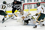 30 November 2009: University of Vermont Catamount goaltender Mike Spillane, a Senior from Bow, NH, pulls in a first period rebound facing the Yale University Bulldogs at Gutterson Fieldhouse in Burlington, Vermont. Spillane made 26 saves to lead the Catamounts to a 1-0 shutout in a rematch of last season's first round of the NCAA post-season playoff Tournament. Mandatory Credit: Ed Wolfstein Photo