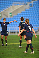 Shannon Boxx (left, #7) and Lauren Cheney (center, #11) celebrate Cheney's game winning goal.  The USA captured the 2010 Algarve Cup title by defeating Germany 3-2, at Estadio Algarve on March 3, 2010.