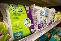 "Packages of Pampers Kandoo brand wipes are seen on a supermarket shelf in New York on Thursday, February 12, 2015. The wipes including other brands, which are advertised as ""flushable"", clog up the sewer systems as they do not break down like toilet paper and should not be disposed of in the toilet. Municipalities are spending millions unclogging sewers and the New York City Council is proposing a ban that would prevent the products from being advertised as ""flushable"". (© Richard B. Levine)"