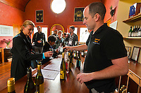 Paul Mason, winemaker pouring wines in the tasting roo, Martinborough Vienyeard, Martinborough, New Zealand