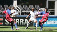 Fabrice Noel (11) kicks the ball against Carlos Palacios (14). Honduras defeated Haiti 1-0 during the First Round of the 2009 CONCACAF Gold Cup at Qwest Field in Seattle, Washington on July 4, 2009.