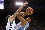 31 December 2013: North Carolina's Marcus Paige (right) is defended by UNC Wilmington's Ben Eblen (left). The University of North Carolina Tar Heels played the UNC Wilmington Seahawks at the Dean E. Smith Center in Chapel Hill, North Carolina in a 2013-14 NCAA Division I Men's Basketball game. UNC won the game 84-51.
