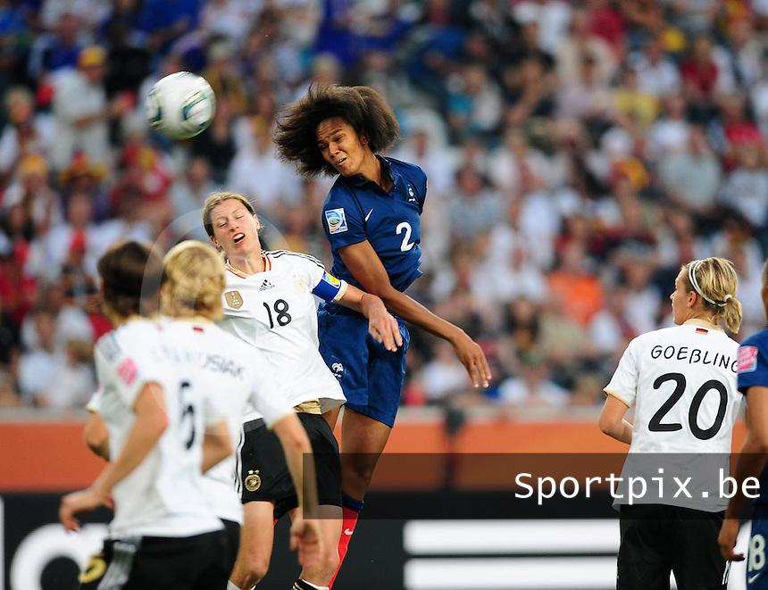 Fifa Women's World Cup Germany 2011 : France - Germany ( Frankrijk - Duitsland ) at Munchengladbach World Cup stadium : Wendie RENARD springt hoger dan Kerstin GAREFREKES om de bal binnen te koppen.foto DAVID CATRY / Vrouwenteam.be