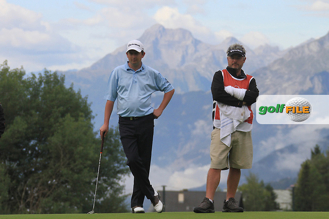 Peter Lawrie (IRL) and Caddy on the 13th during the 1st day of the Omega European Masters, Crans-Sur-Sierre, Crans Montana, Switzerland..Picture: Golffile/Fran Caffrey..