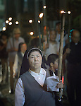 Participants in a torchlight march for peace in Nagasaki, Japan, on August 9, 2015, the 70th anniversary of the day the United States dropped an atomic bomb on the city. The procession began with a Catholic mass at the Urakami Cathedral--which was destroyed by the bombing and rebuilt years later.