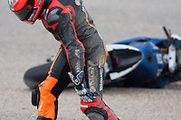 Colin Edwards hurts his knee and is out of the race
