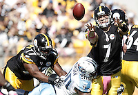 PITTSBURGH, PA - OCTOBER 09:  Ben Roethlisberger #7 of the Pittsburgh Steelers throws a shovel pass while being tackled by Derrick Morgan #90 of the Tennessee Titans during the game on October 9, 2011 at Heinz Field in Pittsburgh, Pennsylvania.  (Photo by Jared Wickerham/Getty Images)