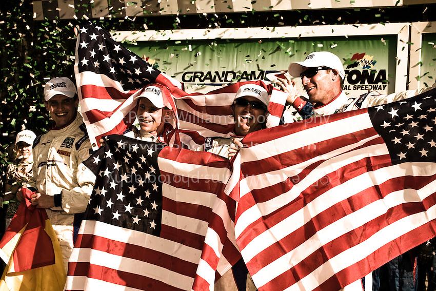 22-25 January, 2009, Daytona Beach, Florida USA.Darren Law, David Donohue, Antonio Garcia & Buddy Rice in Victory Lane..©F.Peirce Williams 2009.F.Peirce Williams.photography