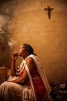 Witch healer Antonia Blaundi (43) smokes marijuana while possessed by the spirit of her father Antonio.
