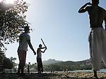 Dominican boys play baseball on a beach, Confresi, Dominican Republic