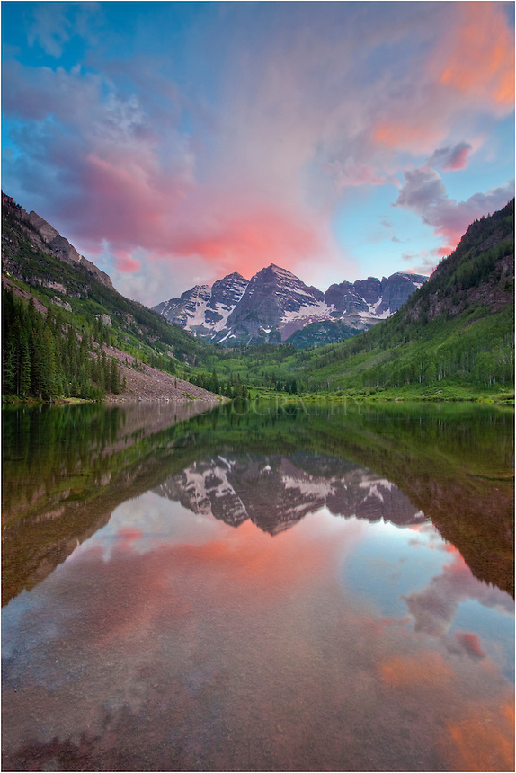 I had gone to the Maroon Bells near Aspen, Colorado to photograph the stars at night on this summer evening. I arrived in the evening to set up and figure out exactly what I wanted in this Colorado picture while it was still daylight. What I found was an exceptionally beautiful sunset. The colors seemed to dance around Maroon Peak and shimmer in the nearby water. I was fortunate to capture this image of Colorado.