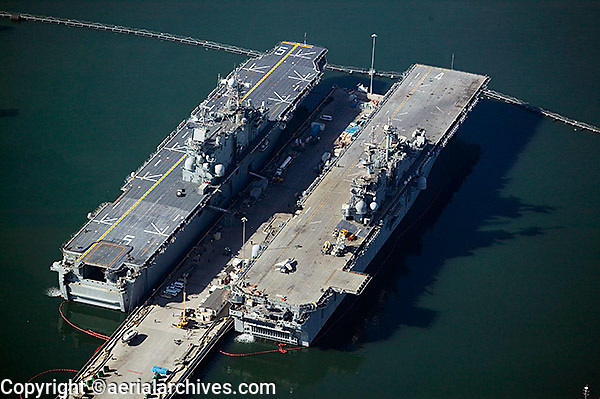 aerial view above two aircraft carriers moored San Diego California