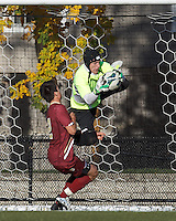 Boston College goalkeeper Alex Kapp (1) catches a cross.Boston College (maroon) defeated Virginia Tech (Virginia Polytechnic Institute and State University) (white), 3-1, at Newton Campus Field, on November 3, 2013.