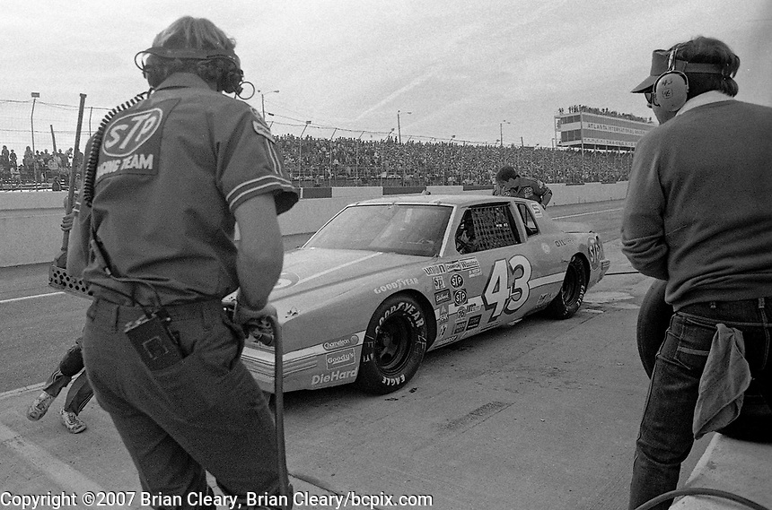 Richard Petty makes a pit stop in the $43 Pontiac Grand Prix en route to a 5th place finish, Atlanta Journal 500 at Atlanta International Raceway in Hampton, GA on November 6, 1983. (Photo by Brian Cleary/www.bcpix.com)