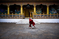 A Buddhist monk is seen outside the prayer hall at the ancient Punakha Dzong (fortress) in Punakha, Bhutan.