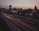 BI52,600-02...WASHINGTON - A 1969 photograph of Interstate 5 passing through downtown Seattle at sunset.