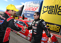 Feb 26, 2017; Chandler, AZ, USA; NHRA pro stock driver Drew Skillman (right) congratulates Greg Anderson as he celebrates after winning the Arizona Nationals at Wild Horse Pass Motorsports Park. Mandatory Credit: Mark J. Rebilas-USA TODAY Sports