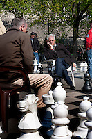 People playing chess in the Parc des Bastions, originally the first botanical garden in Geneva (Switzerland, 16/04/2010)