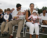 26 August 2007: Nomar Garciaparra, husband of 2007 inductee Mia Hamm (not pictured), feeds their daughter Grace as twin Ava is held by Michelle Greco (r). The National Soccer Hall of Fame Induction Ceremony was held at the National Soccer Hall of Fame in Oneonta, New York.