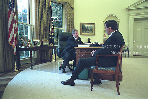 United States President George W. Bush meets with Homeland Security Director Tom Ridge in the Oval Office of the White House in Washington, D.C. on Thursday, November 8, 2001..Mandatory Credit: Eric Draper - White House via CNP.