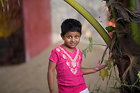 January 28th, 2008_Kerala State, India_ A young girl stands near the banks of the backwaters which is located in the Southern Indian state of Kerala.  The waterways are a signature attraction in Kerala and are also an important link for communities and commerce there.  Photographer: Daniel J. Groshong/Tayo Photo Group