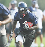 Mississippi's Nicholas Parker (4) runs upfield at football practice in Oxford, Miss. on Sunday, August 7, 2011. (AP Photo/Oxford Eagle, Bruce Newman)