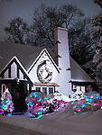 Cute family house decorated with Christmas lights for holidays and covered with snow nighttime scenic. Toronto, Ontario, Canada.