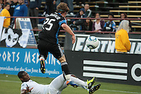 Ellis McLoughlin jumps over his defender on the slide tackle. The Chicago Fire defeated the San Jose Earthquakes after going 5-4 on penalty kicks, after a 2-2 score in regulation during the US Open Cup at Buck Shaw Stadium in Santa Clara, California on May 24th, 2011.