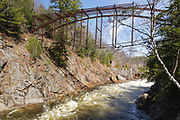 """Remnants of the """"Pumpkin Seed Bridge"""" at Livermore Falls in Campton, New Hampshire USA. This bridge was erected in 1886 by the Berlin Iron Bridge Company and crossed the Pemigewasset River. It is 263 feet long and closed 1959."""