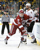 David Valek (Harvard - 22), Jamie Oleksiak (Northeastern - 6) - The Northeastern University Huskies defeated the Harvard University Crimson 4-0 in their Beanpot opener on Monday, February 7, 2011, at TD Garden in Boston, Massachusetts.