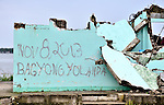 A graffiti reference in the ruins of Basey, a town in the Philippines province of Samar, to the passage of Typhoon Haiyan in November 2013. The storm was known locally as Yolanda.