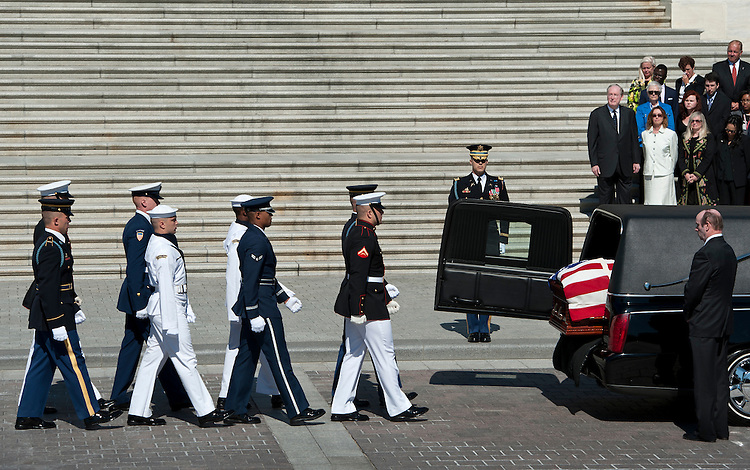 The honor guard prepares to carry casket containing Sen. Robert Byrd's body up the Senate Steps to the Senate Chamber on Thursday, July 1, 2010. Sen. Jay Rockefeller, D-W. Va., stands with members of Sen. Byrd's staff on the steps.
