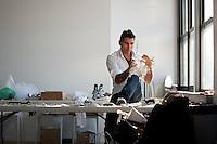 Jeweler to the stars Rodrigo Otazu adjusts a piece of his artwork during a photo shoot in New York, 8 November 2009.